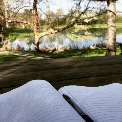 Writing by the pond