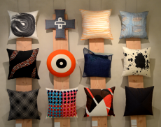 12 pillows hanging on the wall at Designmuseum Danmark