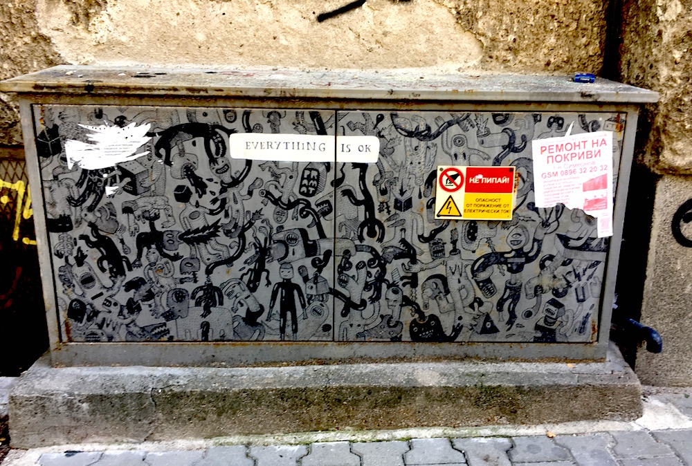 "Street art that says ""everything is okay"" on a power box"