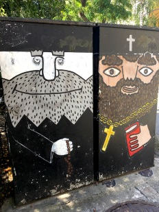 Street art of two cartoon religious priests