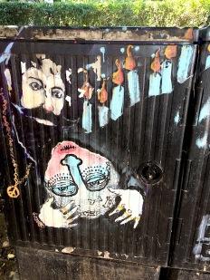 Street art of two strange men